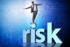 The young businessman in business risk and uncertainty concept Royalty Free Stock Image