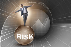 The young businessman in business risk and uncertainty concept Royalty Free Stock Photo
