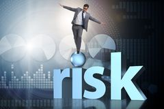 The young businessman in business risk and uncertainty concept Stock Photos