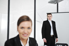 Young businessman and businesswoman in business presentation Stock Photos