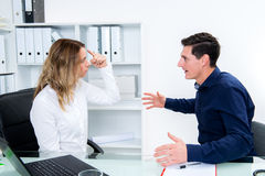 Young businessman and businesswoman in conflict Royalty Free Stock Photo