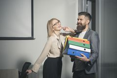 Young businessman and businesswoman with folders and documents in corporation. Business, education and lifestyle concept royalty free stock photography