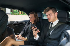 Young Businessman And Businesswoman Traveling In The Car Royalty Free Stock Photo