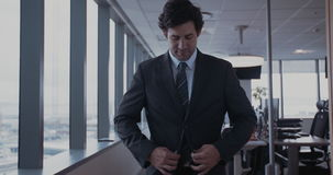 Young businessman buttoning jacket stock footage