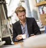 Young businessman in the cafe Royalty Free Stock Images