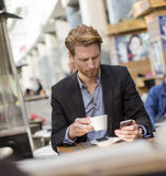 Young businessman in the cafe Stock Images