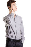 Young businessman calling by cellphone Stock Images