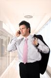 Young businessman is calling on mobile. Royalty Free Stock Photos