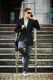 Young businessman calling on mobile phone outdoor Stock Photography