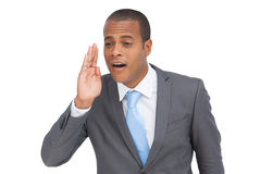 Young businessman calling for someone Stock Image