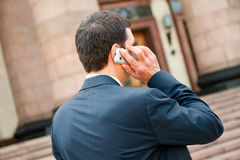 Young businessman calls on mobile Royalty Free Stock Image