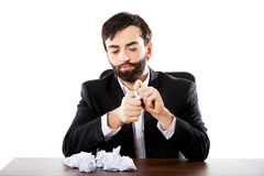 Young businessman can't find an idea. Royalty Free Stock Image