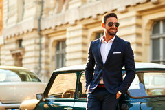 Young businessman at a car Royalty Free Stock Images