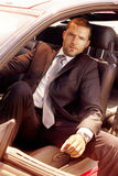 Young businessman in the car. Young male model in the cabin of the car Royalty Free Stock Photography