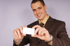 Young businessman with card royalty free stock photos