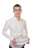 Young businessman carrying books. Business man is carrying books with a smile Stock Image