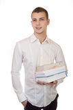 Young businessman carrying books. Business man is carrying books with a smile Royalty Free Stock Photography