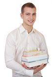 Young businessman carrying books. Business man is carrying books with a smile Stock Photo