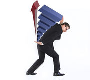 Young businessman carrying a graphic Royalty Free Stock Image