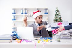 The young businessman celebrating christmas in the office Royalty Free Stock Image