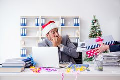 The young businessman celebrating christmas in the office Stock Photography