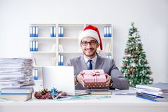 The young businessman celebrating christmas in the office stock photos