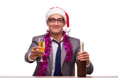 The young businessman celebrating christmas in office Royalty Free Stock Photos