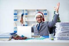 The young businessman celebrating christmas in the office Stock Image