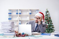 The young businessman celebrating christmas in the office Stock Photo