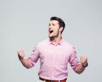 Young businessman celebrating his success Stock Photos