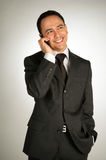 Young businessman with cellphone Stock Images