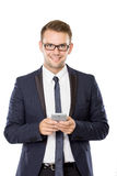 Young businessman with a cellphone on his hand Stock Images