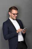 Young businessman with a cellphone on his hand Royalty Free Stock Photos