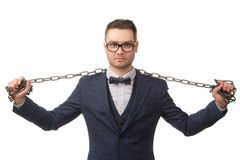 Young businessman with chains on  hands and shoulders Stock Photo