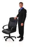 Young businessman with chair Stock Photo