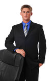 Young businessman with chair. Young businessman standing with chair isolated on white Royalty Free Stock Photography