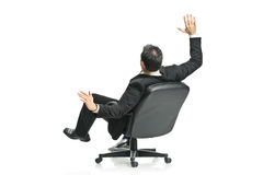 A young businessman in a chair. Isolated on a white background Royalty Free Stock Photography