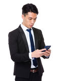 Young businessman check the email on cellphone Royalty Free Stock Photography