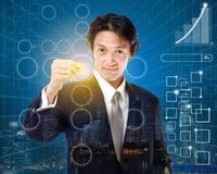 Young businessman checking mark on checklist with marker. Busine Stock Photography