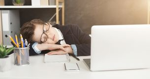 Young businessman child in business suit get tired and fell asleep royalty free stock photography