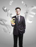 Young  businessman chooses a Gold Euro Sign Stock Photos