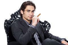 Young businessman with cigar Stock Images