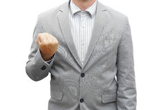 Young businessman clenched his fists after after making a succes Stock Image