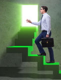 The young businessman climbing career ladder Royalty Free Stock Photo