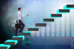 The young businessman climbing career ladder Royalty Free Stock Photography