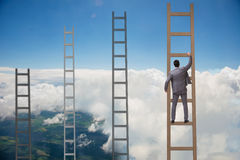 The young businessman climbing career ladder Royalty Free Stock Images