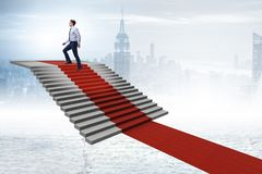 The young businessman climbing stairs and red carpet. Young businessman climbing stairs and red carpet Royalty Free Stock Photos