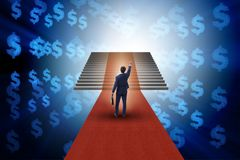The young businessman climbing stairs and red carpet. Young businessman climbing stairs and red carpet Royalty Free Stock Photo