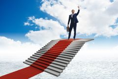 The young businessman climbing stairs and red carpet into sky. Young businessman climbing stairs and red carpet into sky Royalty Free Stock Photos