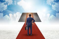 The young businessman climbing stairs and red carpet into sky. Young businessman climbing stairs and red carpet into sky Royalty Free Stock Photo